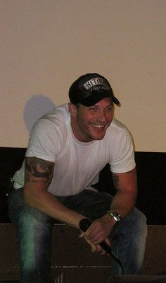 OMG. Absolutely loving this picture of TH!! That hat, white T, jeans, smile, arms......yeah.....my ideal guy right here!!!