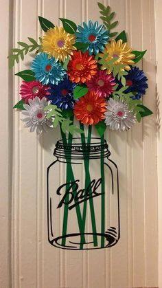 Mason jar flowers out of paper and vinyl stems and jar. Inspiration only no link