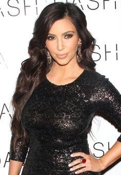Kim Kardashians wavy, brunette hairstyle