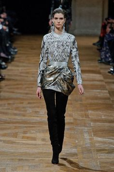 Balmain Fall 2013 Richly embellished and jeweled. Long fitted sleeves, with the top cut like a tunic.