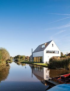 """For this canal-adjacent home on the outskirts of Amsterdam, local studio Équipe blended aspects of the Dutch vernacular, such as a pitched roof, with the """"indoor-outdoor feel"""" of Caribbean architecture. Photo by: Tim Van de Velde"""