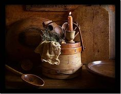 Colonial.  Click this picture to enlarge it and to really appreciate the beautiful old wooden items.