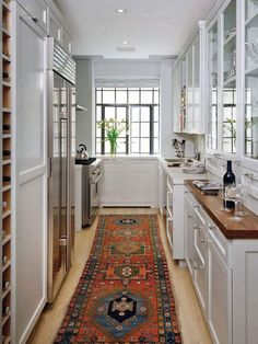 White kitchen + rug