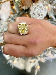 This cushion cut halo engagement setting features a stunning yellow diamond center stone. #yellowdiamond #diamond #engagementring #engagementsetting #setting #ring #yellow #cushion #cushioncut #halo