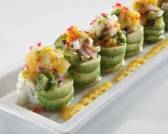 Pacific Roll (RA Sushi) - A spicy mix of albacore, cilantro, jalapeño & cucumber rolled & topped with fresh avocado & mango salsa; finished with red beet tempura bits & sautéed cashew nuts