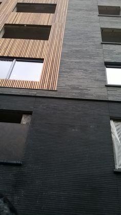 Gevelbekleding: gelijmde baksteen + hout