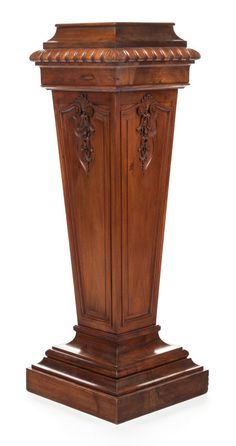 A VICTORIAN CARVED MAHOGANY NEOCLASSICAL PEDESTAL. 20th century