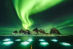 The aurora borealis dances over a salmon farm off the coast of Norway in this National Geographic Your Shot Photo of the Day. Photographie National Geographic, National Geographic Photography, Photography Photos, Amazing Photography, Travel Photography, Canon Eos, Cave Images, Midwest Vacations, National Geographic Photo Contest