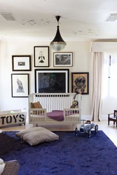 Love this nursery.  Get a similar look with the distressed wool rug in navy or denim from RH Baby & Child. #rhbabyandchild #fallinlove