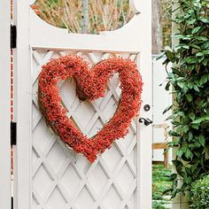 Nandina Heart Shaped Wreath | Gather, wrap, and wire—it's as simple as that. Nandina berries are at their peak, so warm your welcome with a bright wreath made with love. | SouthernLiving.com