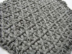 hexagon loom, makes a star stitch this looks like the shawl/poncho the young lady was just wearing in line at Hickory Farms. I need to try this but on a much larger scale.