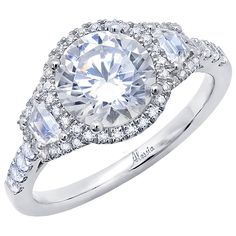 Time to sparkle with our latest design from the Alessia Collection. Featuring a 2ct round brilliant cut center stone and two unique trapezoid side stones giving this ring the perfect 3 stone look.
