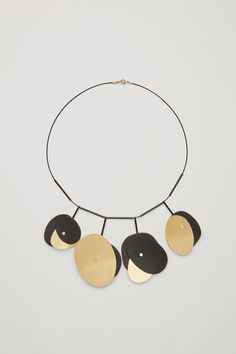 COS image 1 of Short necklace with leather shapes in Gold