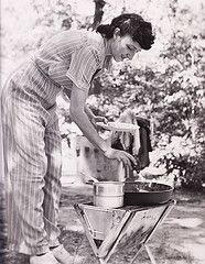 Camp cooking 1940! Don't we all dress like this when we go camping?