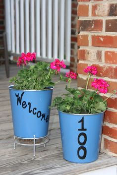 www.glampinz.weebly.com ; This cost $1! The Dollar Tree has these blue trash cans;punh a hole in the bottom;use a paint pen to decorate;plant your flower of choice. EASY! CHEAP! CUTE!
