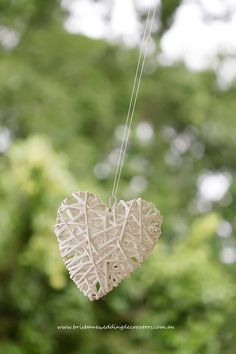Its the little details like these gorgeous hanging wicker hearts really set the tone for a wedding with the wow factor.  By Brisbane Wedding Decorators  www.brisbaneweddingdecorators.com.au