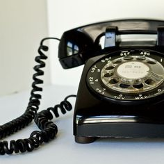Vintage phone..we had two black phones like this-one in the downstairs hall and one in my parent's bedroom-also we had a party line.