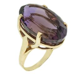 Dramatic 42 Carat Amethyst Gold Ring | From a unique collection of vintage cocktail rings at https://www.1stdibs.com/jewelry/rings/cocktail-rings/