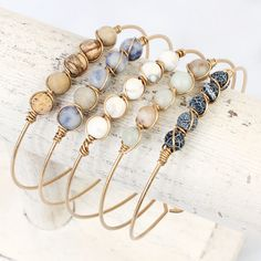 A simple yet eye-catching wired bracelet adorned with 5 beautiful earthy natural stones! Toggle closure makes it easy and comfortable for all-day wear.