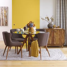 Urban Barn Bonnie Dining Table & Chairs | Sculptural shapes and cosy quilting offer a warm new spin on mid-century modern style. GREAT FOR… Small spaces, thanks to the table's slim frame and glass top.