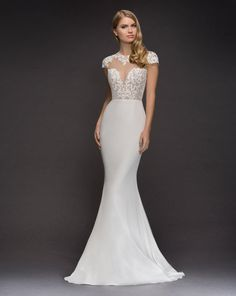 Style 1819 Daisy Blush by Hayley Paige bridal gown -Ivory silk crepe sheath bridal gown, appliquéd illusion bodice with cap sleeve and sweetheart neckline, open keyhole back, fitted crepe skirt.