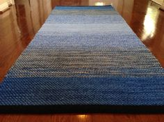 Blue Twill Rag Rug. I've always left the fringe on each end of my handwoven rugs but this style has a more finished appearance and looks 'less country'...I like it.