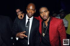 Nas hit the stage following a 45 minute comedy set by Dave Chappelle, in a red, snakeskin print tuxedo jacket over a black collared shirt and slacks, completing the look with a gold medallion. Description from examiner.com. I searched for this on bing.com/images