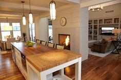 Details from bead board ceilings with beams to a double sided fireplace to dining room at glass front doors onto patio. I like the lay out and flow of this space, well defined AND open!
