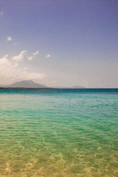 Sosua beach is one of the most beautiful and easily accessible on the island. Crystal clear water with a great view of the sun setting behind the mountains  Dominican Republic