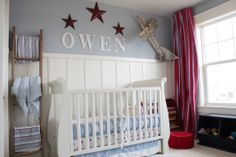 Stars and Stripes, Red, white,  blue, stars and stripes make up my little guys room. He loves his room , a bookcase sits in the corner with an antique, rustic wooden airplane hanging above. the other side has an old ladder to hang blankets on       , Nurseries Design
