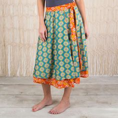 Reversible Wrap Skirt - Get creative with our blue and orange floral Reversible Wrap Skirt! Can be worn as a skirt, strapless dress, or even halter style! The cotton sateen fabric reflects light for a beautiful finish. Tag includes different ways to wear. ALL SALE ITEMS ARE FINAL SALE. Please refer to our Return Policy for more information.