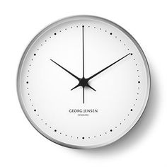 Koppel wall clock from Georg Jensen is designed by Henning Koppel, one of Georg Jensen's most famous designers throughout the years. This wall clock has a modern touch where the pure white meets the lustrous stainless steel. Products that are designed by Henning Koppel often have a clean foundation with small yet decorative details, as in this wall clock where the small black dots gives it that little extra.