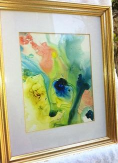 Creation Mysterya watercolor painting which combines vibrant yellow and blue with soft pinks and greens in transparent layers which suggest the mixing and fl