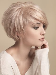 Short round layers // side swept bangs