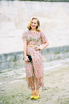 What an adorable jumpsuit, romantic side-swept hair, and sunny stacked yellow heels.  Love it.