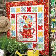 Every Bloomin' Thing: Charming Pieced Appliquéd Wall Quilt Pattern  Designed by JILL FINLEY Machine Quilted by MAIKA CHRISTENSEN