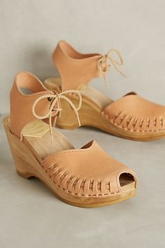 Not that a sugar daddy would ever finance these, but I'd need one to afford these fugly beauties.  I just love the slightly corrective suggestion of the ankle ties. Sheepish Domitila Wedges #anthropologie