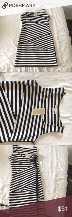 NWT Michael Kors Black & White Striped dress Michael Kors black & white striped dress with black side zipper, size 8 & 10 available Michael Kors Dresses Mini