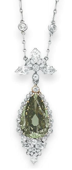"A BELLE EPOQUE COLORED DIAMOND PENDANT NECKLACE   Set with a pear-shaped fancy dark gray-yellowish green diamond, weighing approx 5.84 cts, to the collet-set old European & marquise-cut diamond surround & foliate link, from a platinum fine link neckchain, spaced by collet-set old European-cut diamonds, mounted in gold & platinum, ca 1910, 17""."