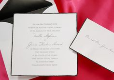 The feather edges of this bright white square invitation are hand painted with black lacquer. Simply stunning!