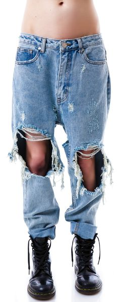 I'm not big on blue jeans, but these destroyed baggy jeans are pretty cute. I'd pair it with a black crop top. UNIF Twerk Jeans | Dolls Kill