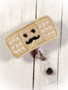 A personal favorite from my Etsy shop https://www.etsy.com/listing/243676206/cute-band-aid-w-happy-face-felt-name
