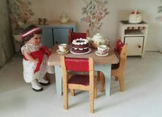 My doll's house is a GeeBee DH9 made between 1964 and 1966. My doll's house kitchen furniture is by Twiggs.