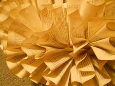 Book wreath. paint the edges of the book, accordian fold the pages, staple, then glue the pages to wreath form