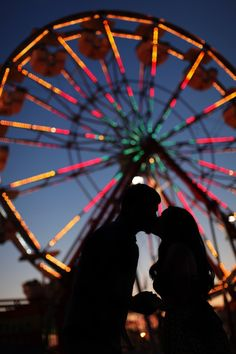 Silhouetted against a giant Ferris Wheel. Could this picture BE any happier? :) #indian #wedding #photo