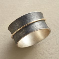 """SPUN INTO GOLD RING--Like a wisp of straw spun into gold, a 14kt ring spins on its base band of etched, oxidized sterling silver. Handmade in whole sizes 5 to 9. 7/16""""W. This ring is licensed under U.S. patent nos. 6,497,117 and 6,395,732."""