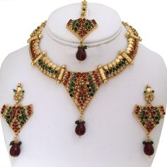 Gold plated Red and Green Polki fashion jewelry set-0211PLK110  http://www.craftandjewel.com/servlet/the-813/Gold-plated-Red-and/Detail