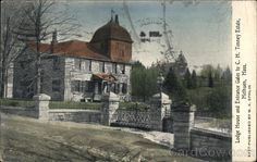 Tenney | Lodge House and Entrance Gates to C. H. Tenney Estate, Methuen, Mass. (4 Jun 1911). Tenney Gatehouse is now on the National Register or Historic Places. Grey Court Castle (seen in the distance) was destroyed by arson.
