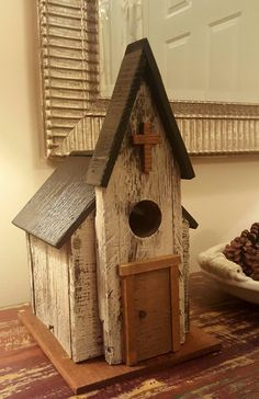 Rustic Church birdhouse made of pallet wood and scraps laying around garage. I love it...