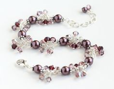 Dusty Plum Cluster Bracelet with purple Swarovski pearls, pink and purple Swarovski crystals, and sterling silver. By OpheliasJewels on Etsy.